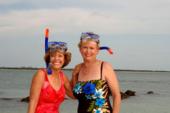 Active older women snorkel Stock Images