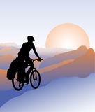 Active outdoor lifestyle concept. Cyclist travels to mountains. Silhouette. Active outdoor lifestyle concept Royalty Free Stock Photo