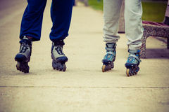 Active people friends rollerskating outdoor. Stock Image