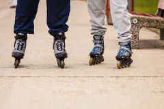 Active people friends rollerskating outdoor. Royalty Free Stock Photo