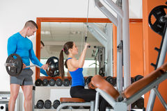 Active people at gym. Young active sporty people at gym doing exercise Stock Photo