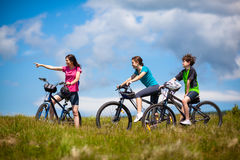 Family biking. Active people - mother and kids biking Royalty Free Stock Photos