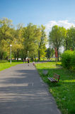 Active people park. Footpath with active people at the Malta park on a sunny day in Poznan, Poland Stock Photos