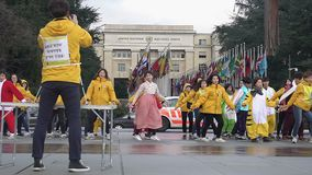 Active people performing symbolic dance near UN Office, freedom of expression. Stock footage stock footage