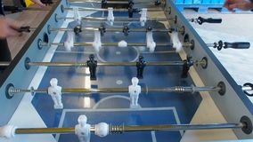 Active people playing foosball. table soccer plaers. Friends play together table football.  stock video