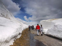 Active people, Snow Drifts on Mountain Road Stock Photos