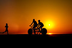 Active people on sunset Stock Photography