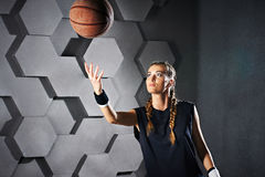 Active playing girl with a basketball Stock Photos