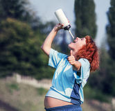 Active pregnant woman drinking water Stock Images