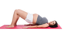 Active pregnant woman working out Royalty Free Stock Images