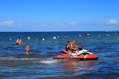 Active recreation - driving on a hydrocycle on the Baltic Sea Stock Photos