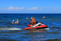Active recreation - driving on a hydrocycle on the Baltic Sea Stock Photo
