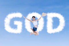 Active religious woman jumping Stock Photos