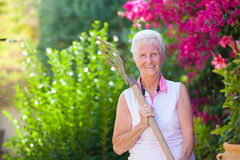 Active retierment, fit senior gardening Royalty Free Stock Photos