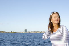 Active retired beautiful woman water background Royalty Free Stock Photos