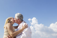 Active retired people, romantic elderly couple in love and kissi Stock Photo
