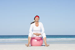 Active retirement mature woman at beach Stock Photo