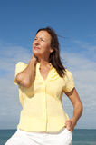 Active retirement woman ocean Stock Photo