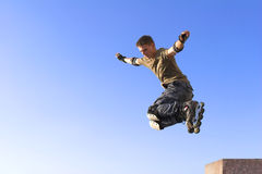 Active roller boy jumping Royalty Free Stock Images
