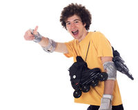 Active roller boy with roller skates. Active roller boy with roller skates over his shoulder showing ok sign. Isolated on white Royalty Free Stock Images