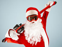 Active Santa. Claus in goggle holding ski royalty free stock images