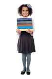 Active school child carrying stack of books Stock Photography
