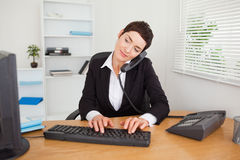 Active secretary answering the phone Royalty Free Stock Photo