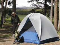 Active Senior 2. Senior man camping in Devil Tower National Park, USA Stock Photo