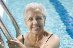 Active senior. Mature lady in the pool Stock Image
