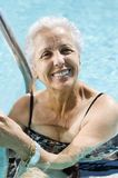 Active senior. Mature lady in the pool Royalty Free Stock Image