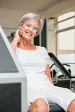 Active senior. Active and smiling senior in a gym stock photos