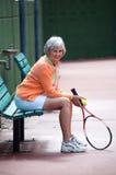 Active Senior. On the tennis court royalty free stock photos