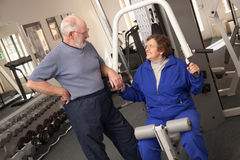 Active Senior Adult Couple Working Out Together in the Gym Stock Image