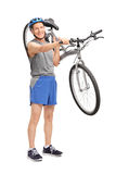 Active senior biker carrying his bicycle Royalty Free Stock Images