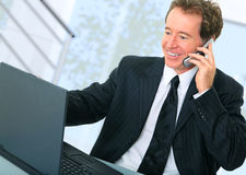 Active Senior Businessman On The Phone In Office Royalty Free Stock Photos