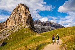 Free Active Senior Caucasian Couple Hiking In Mountains With Backpacks, Enjoying Their Adventure. Location: Dolomites Alps, South Tyrol Royalty Free Stock Photo - 146555115