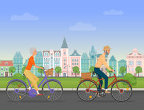 Active senior character, age travelers. Old age retired tourists couple. Elderly people riding on a bicycle near old Stock Image