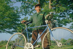 An active senior citizen and his bicycle, Royalty Free Stock Image