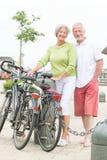 Active senior couple. With bikes royalty free stock photo