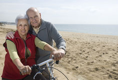 Active senior couple biking Royalty Free Stock Image