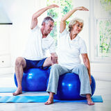 Active senior couple doing aerobics on ball. At home royalty free stock images