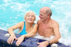 Active senior couple enjoying jacuzzi Royalty Free Stock Photography