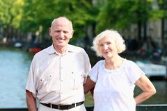 Active senior couple enjoying trip to Amsterdam Royalty Free Stock Images