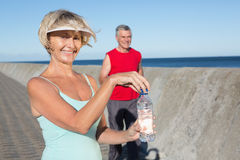 Active senior couple out for a jog. On a sunny day stock image
