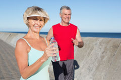 Active senior couple out for a jog Stock Photos