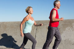 Active senior couple out for a jog. On a sunny day Stock Images