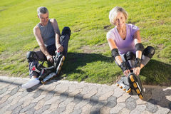 Active senior couple ready to go rollerblading Stock Images
