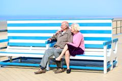Active senior couple relaxing at the sea Royalty Free Stock Photography