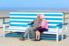 Active senior couple relaxing at the sea royalty free stock photo