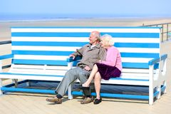Active senior couple relaxing at the sea Stock Photo